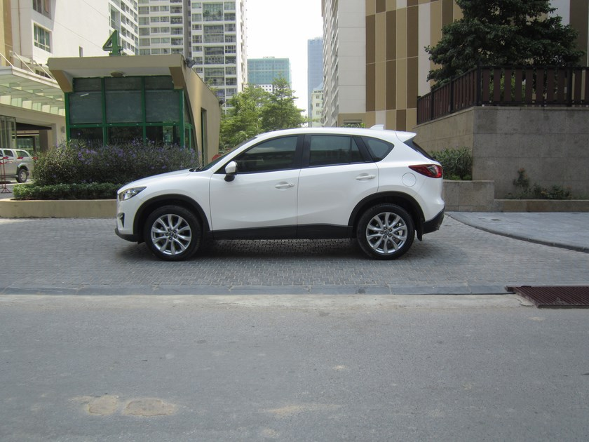 Cần bán gấp Mazda CX 5 sản xuất 2014, màu trắng