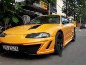 Bán ô tô Mitsubishi Eclipse năm 1996, màu vàng, xe nhập giá 250 triệu tại Tp.HCM