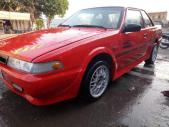 Cần bán Mazda 626 hai cửa màu đỏ giá 45 triệu tại Hậu Giang