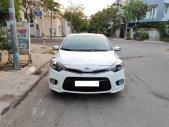 Cần bán lại xe Kia Cerato 2014, màu trắng, xe nhập, giá tốt giá 570 triệu tại Tp.HCM