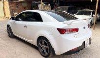 Cần bán Kia Cerato sản xuất năm 2010, màu trắng, nhập khẩu giá 415 triệu tại Tp.HCM